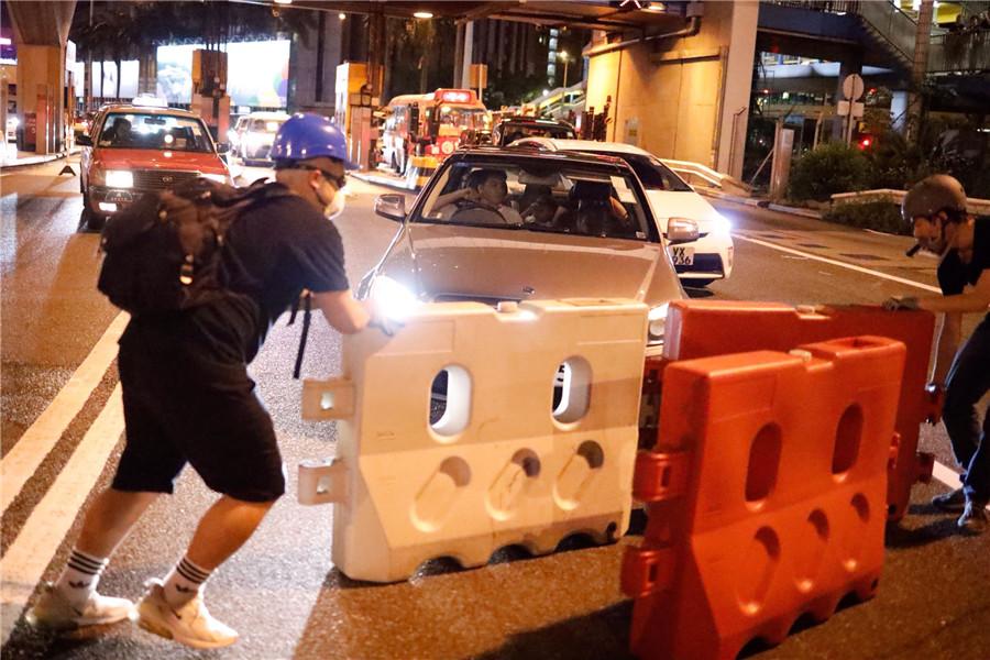 HK to hold accountable violators behind protests