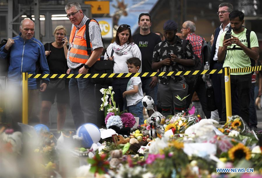 People mourn 8-year-old killed by moving train in Frankfurt, Germany
