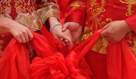 Couples attend group wedding ceremony