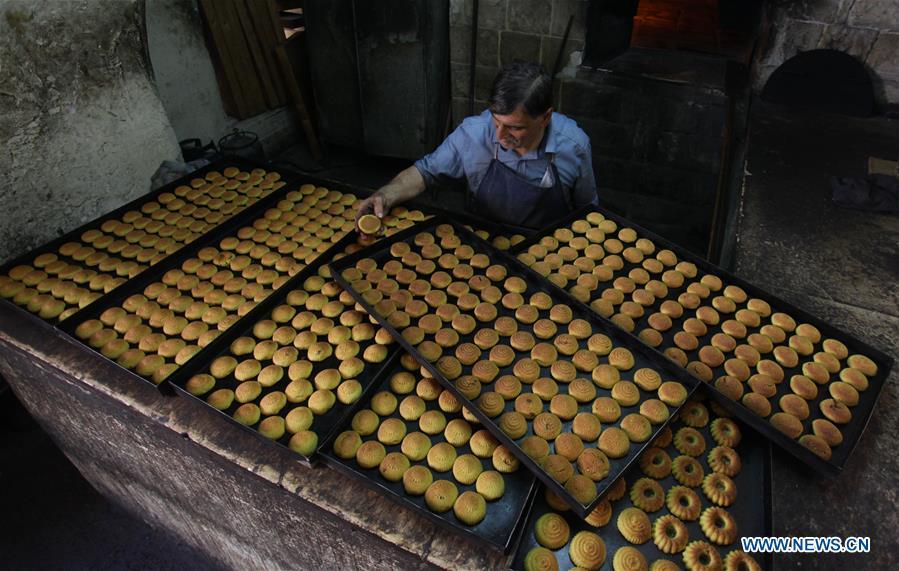 Palestinian vendor prepares traditional cookies for Eid al-Adha in Nablus