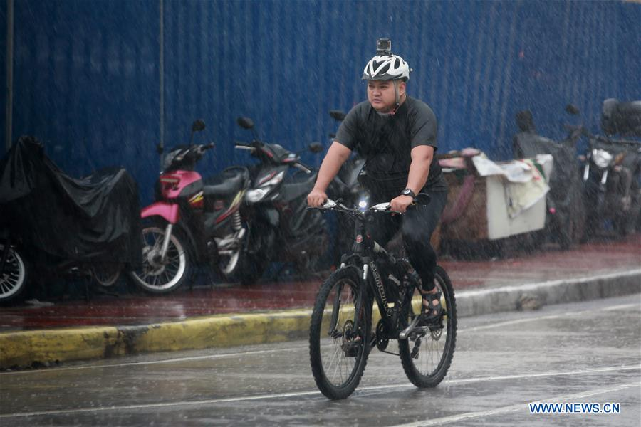 People brave strong winds, heavy rain in Quezon city