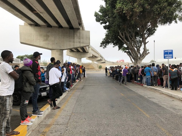 In Mexico, thousands more names added to border wait lists