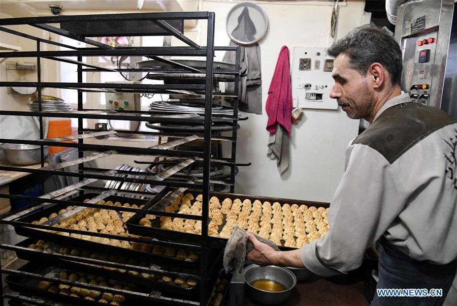 Syrian sweet makers prepare cookies for upcoming Eid al-Adha