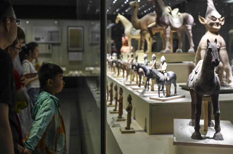 Visitors view exhibits at Xinjiang Uygur Autonomous Region Museum