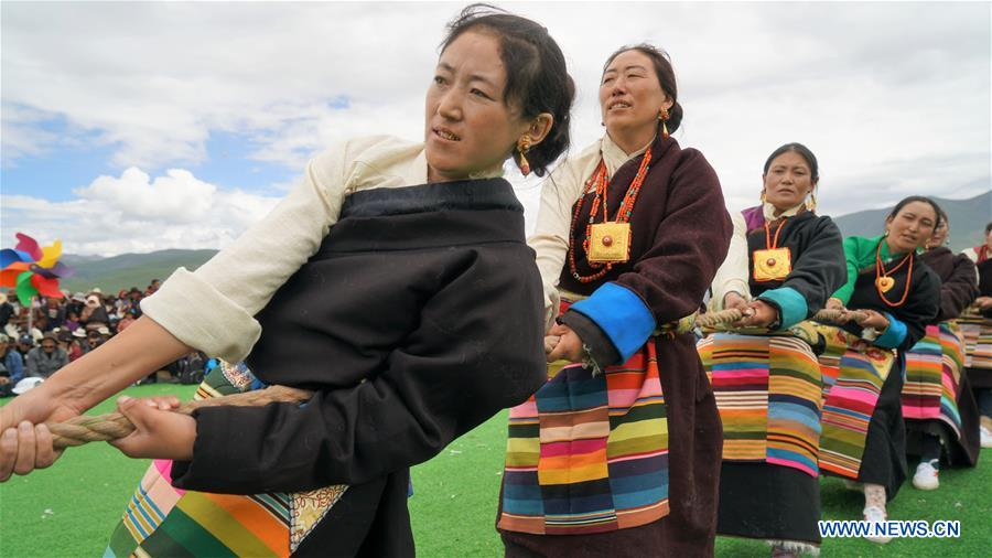 Herdswomen from China's Tibet take part in traditional game