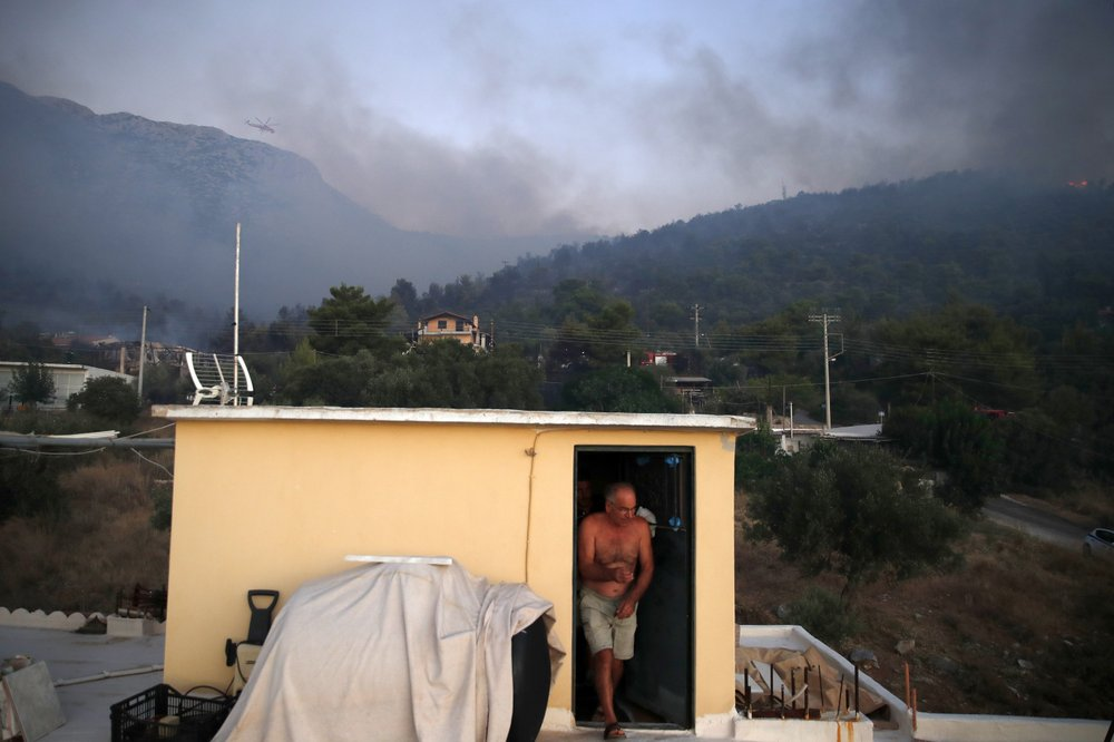 Fire east of Athens under control; some homes damaged