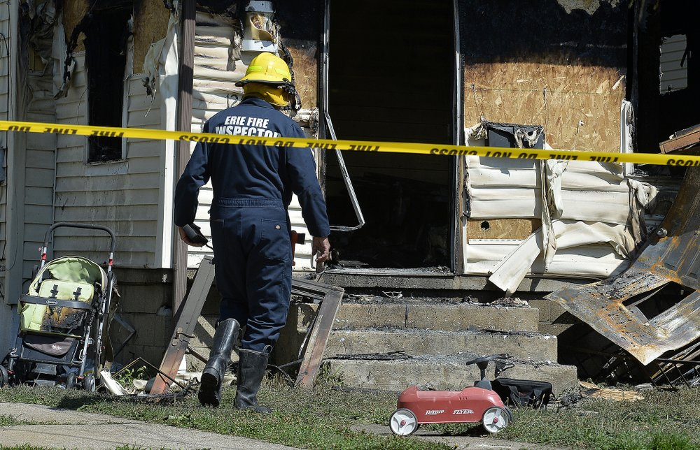 Firefighter was dad to 3 of 5 kids killed in day care blaze