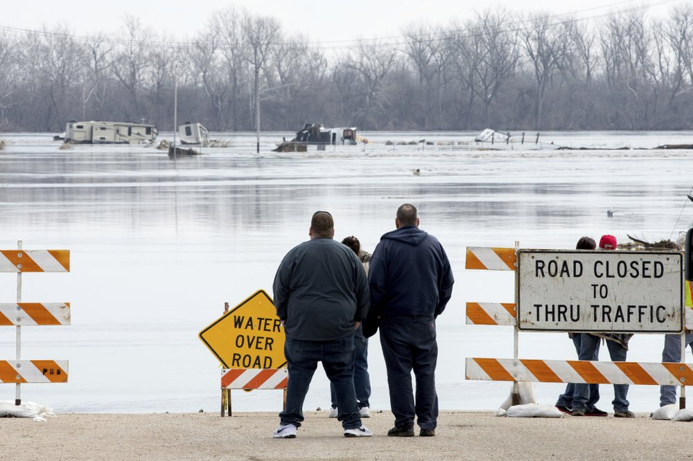 US States brace for long-term flood fight as damages mount