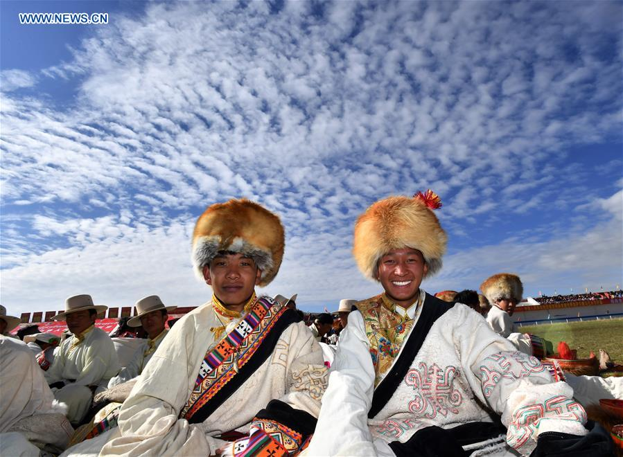 In pics: people wearing hats during horse racing festival in China's Tibet