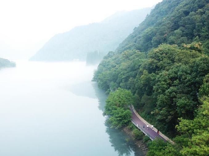 Aerial view of Xin'anjiang River shrouded in fog in east China's Zhejiang