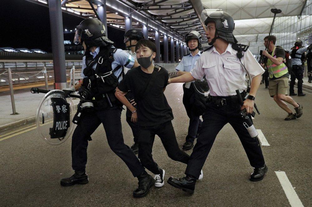 Hong Kong police condemn violent protesters at airport, make five arrests