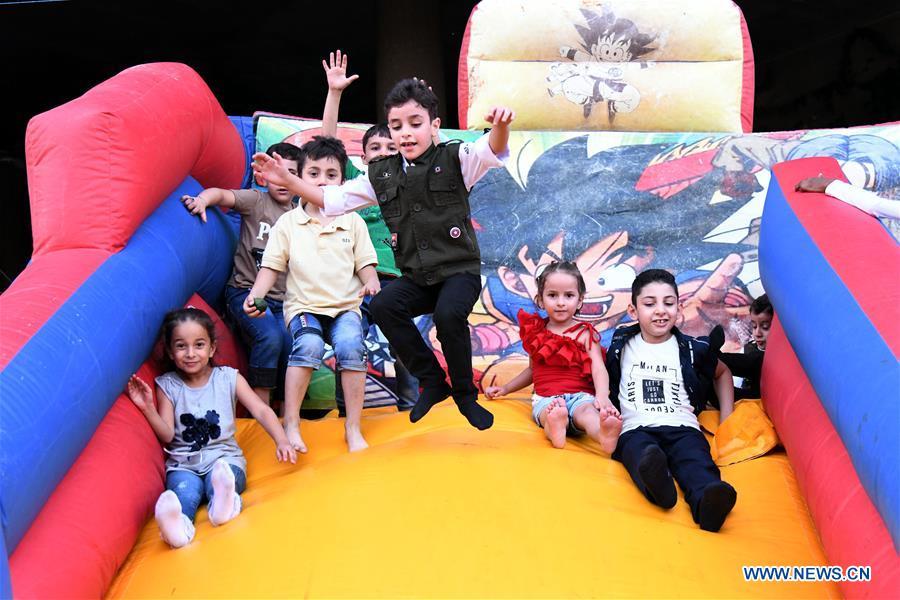 Children enjoy holiday of Eid al-Adha in Damascus, Syria