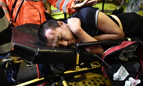 HK affairs office condemns 'near terrorist acts' by rioters at airport