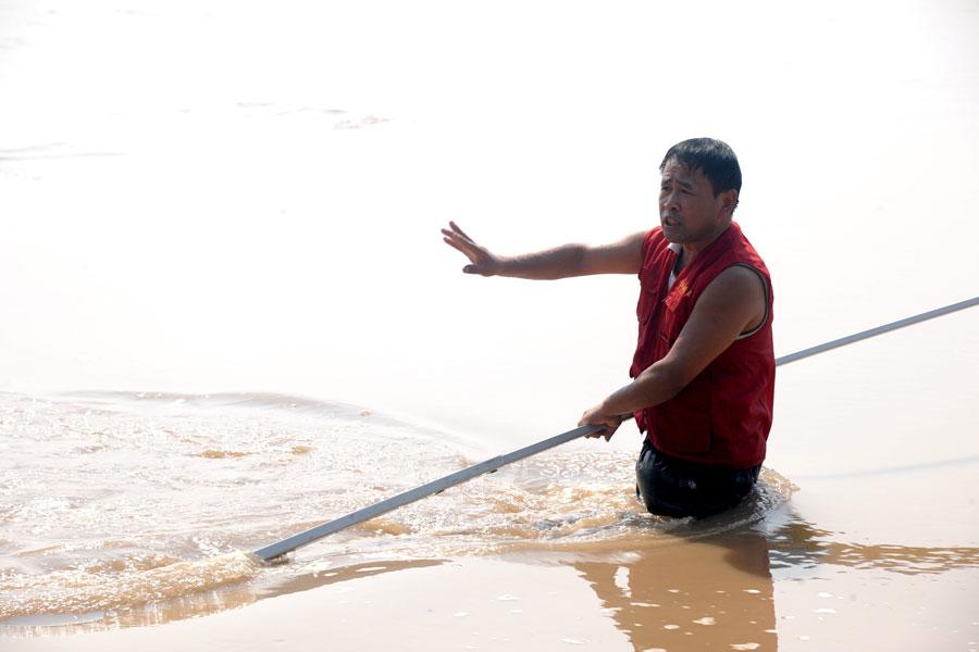 Villager patrols river to keep kids safe
