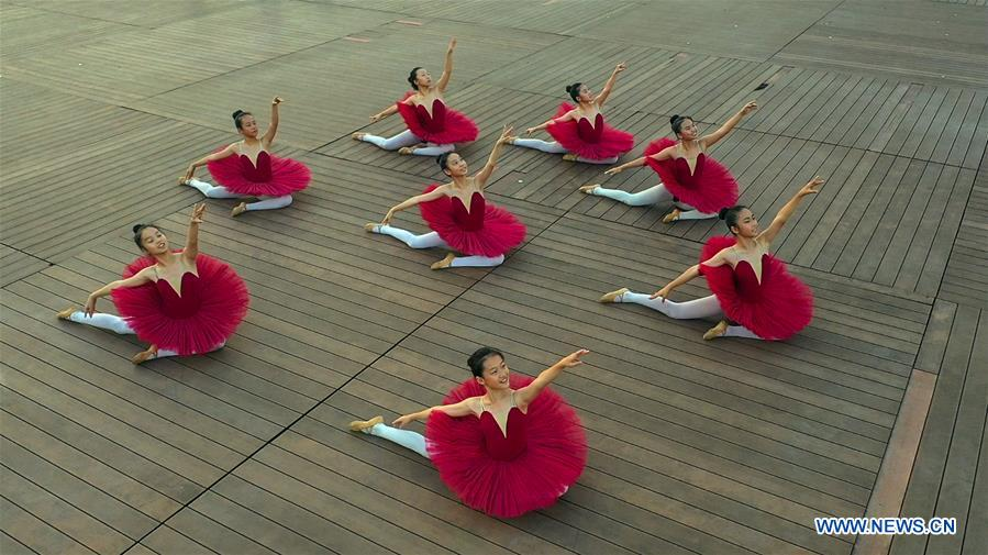 Young ballet dancers in China's Guangxi take part in various cultural events during summer vacation