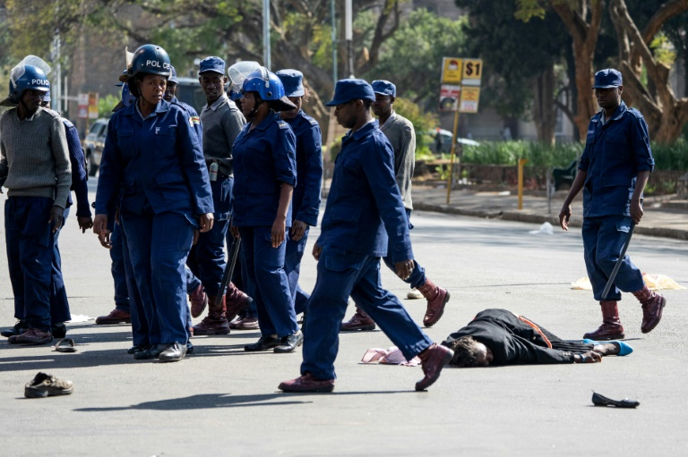 Zimbabwe police beat protesters defying 'rogue' government