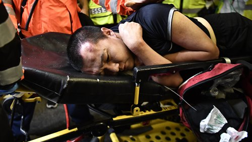 Dark faces of HK rioters blacked out by Western media