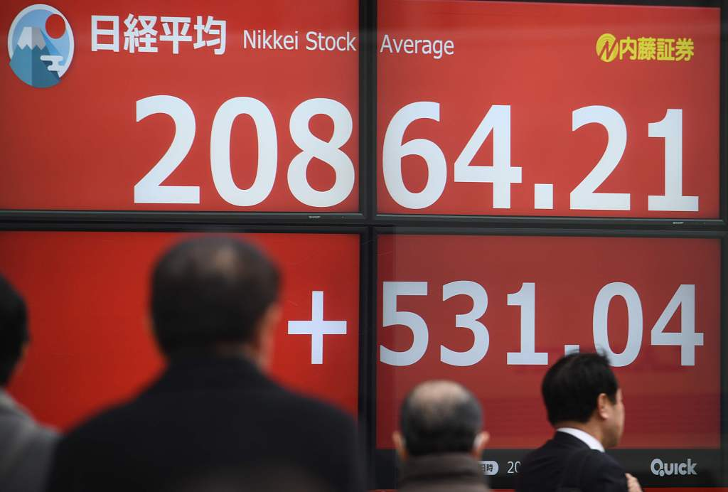 Tokyo stocks rise in morning on receding fears over global recession
