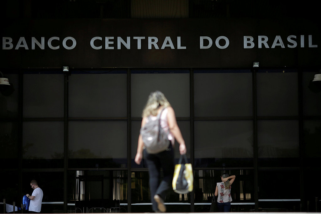 Brazil's central bank sells dollars to prop up real