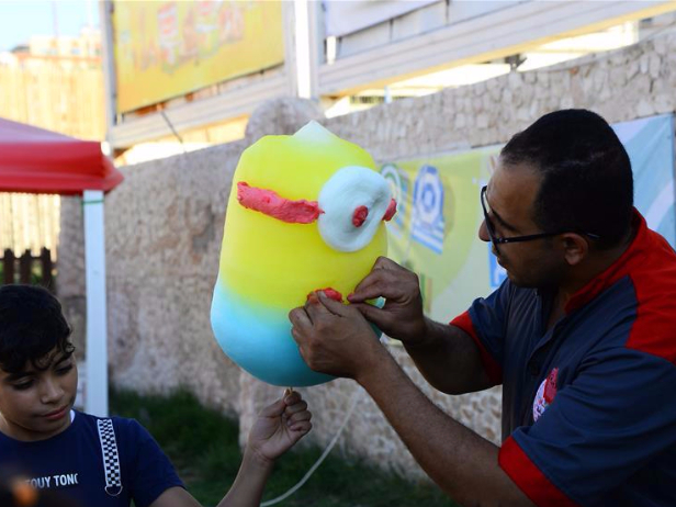 People make cotton candies in Gaza city