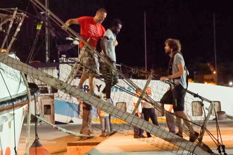 Migrants in limbo again after landing in Italy
