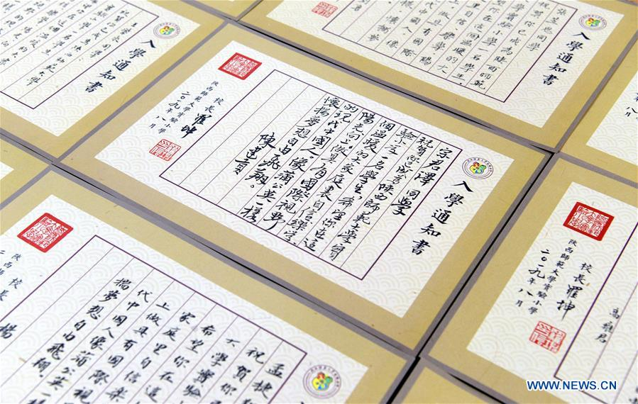 Admission letters written by calligraphers to be delivered to freshmen in China's Shaanxi