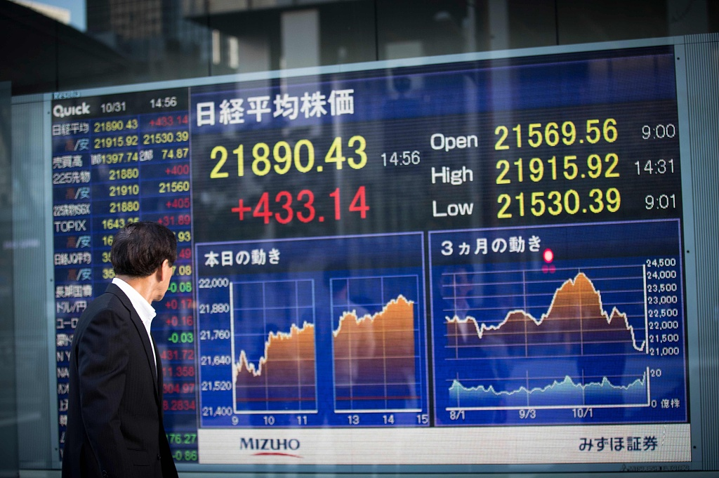 Tokyo shares open flat amid caution ahead of Powell's speech