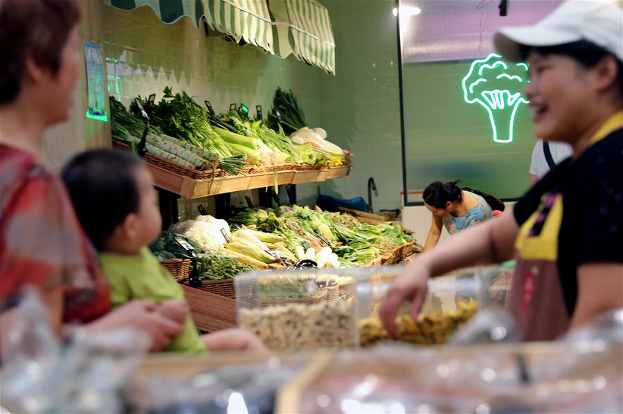 From messy vegetable market to renovated Li'an market