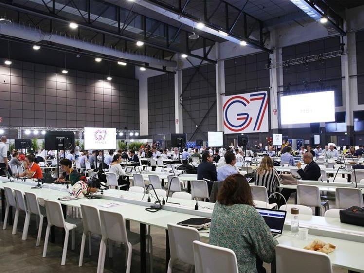 Journalists work at G7 summit press center in Biarritz, France