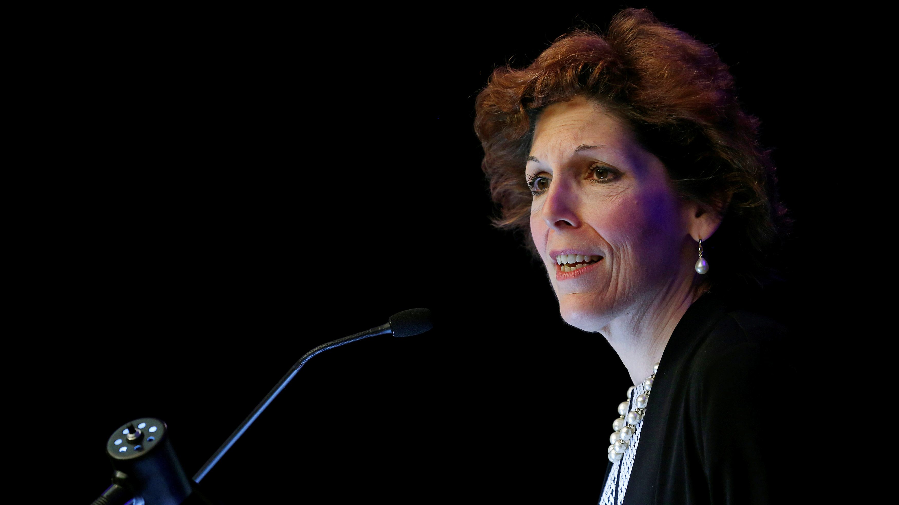 US Fed's Mester sees downside risk from escalating trade war