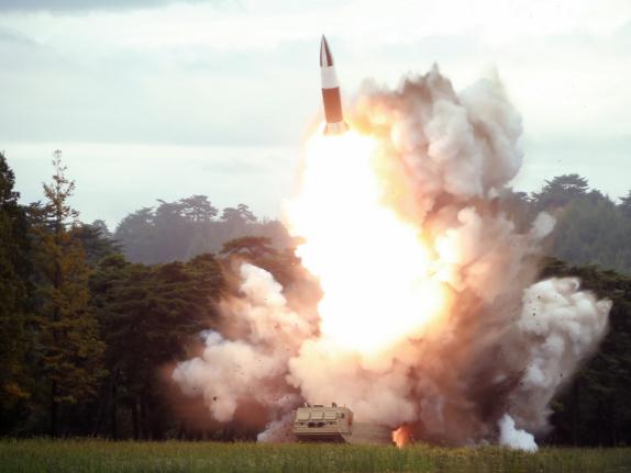 Top DPRK leader guides test-firing of new multiple rocket launcher -- KCNA
