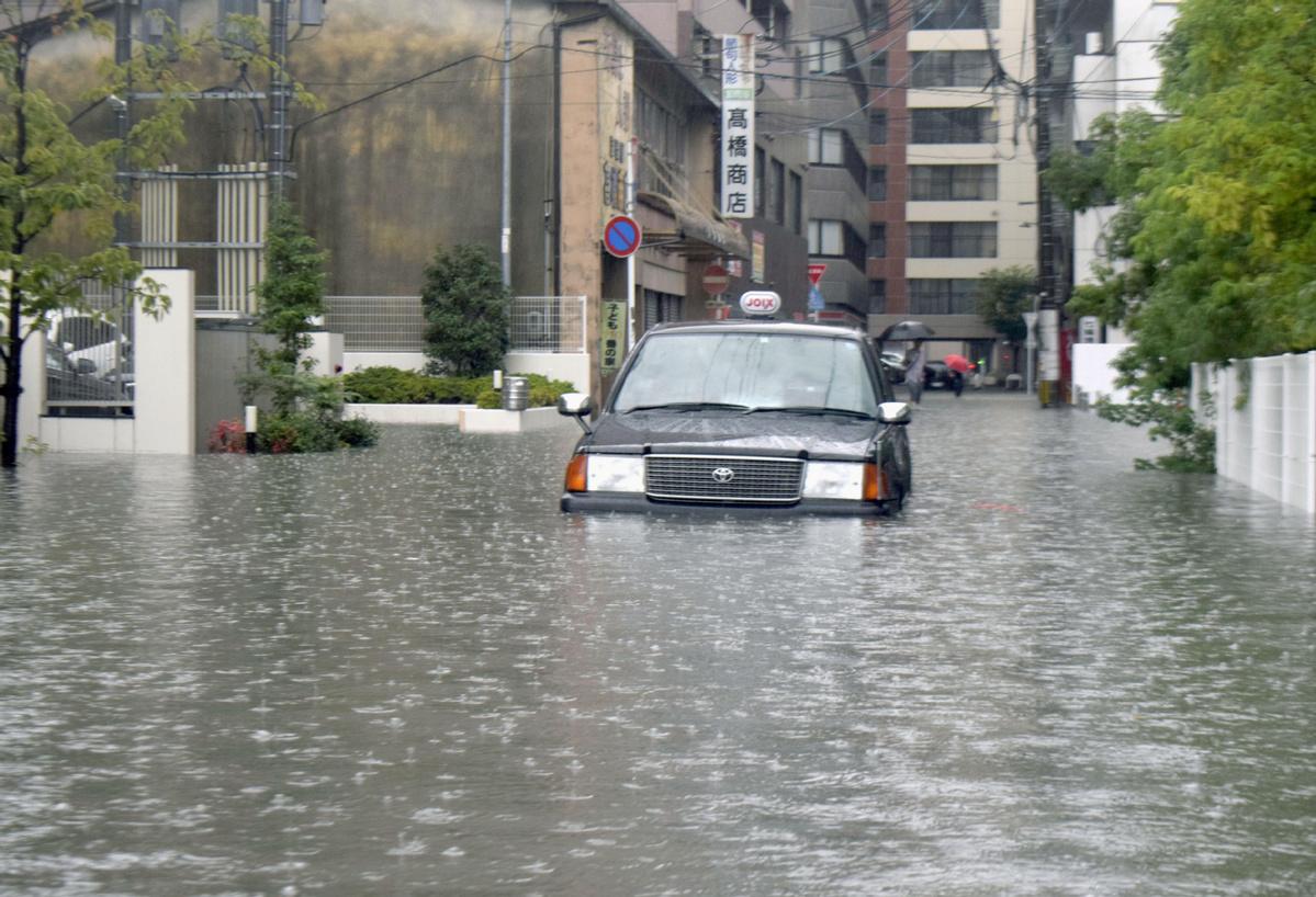 Highest-level landslide, flood alerts issued for western Japan