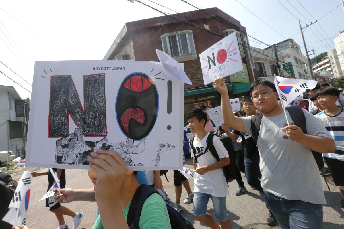 Seoul slams Tokyo as curbs take effect