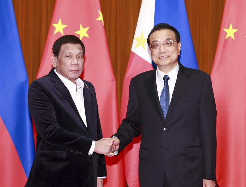 China, Philippines common interests 'far greater' than differences: Premier Li
