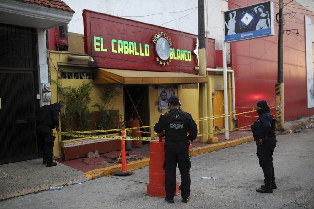 Families angry after gang burns Mexico bar, kills 28
