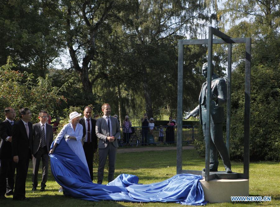 Denmark's Queen Margrethe II unveils statue of Bernhard Arp Sindberg in Aarhus
