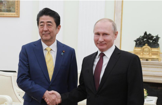 Japan's Abe departs for Russia to meet Putin
