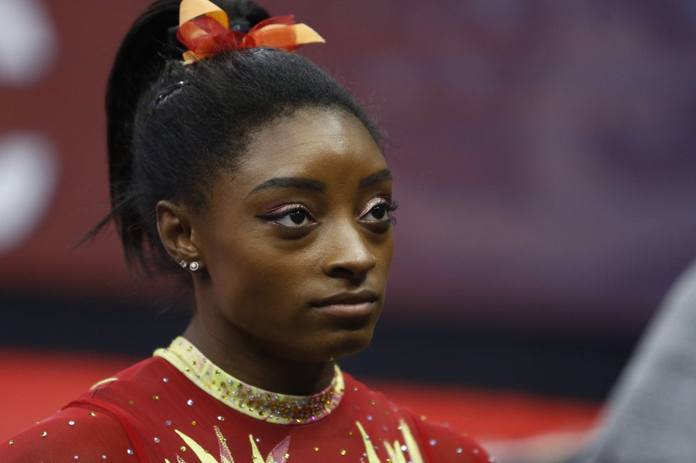 Simone Biles 'aches' for victims after brother charged