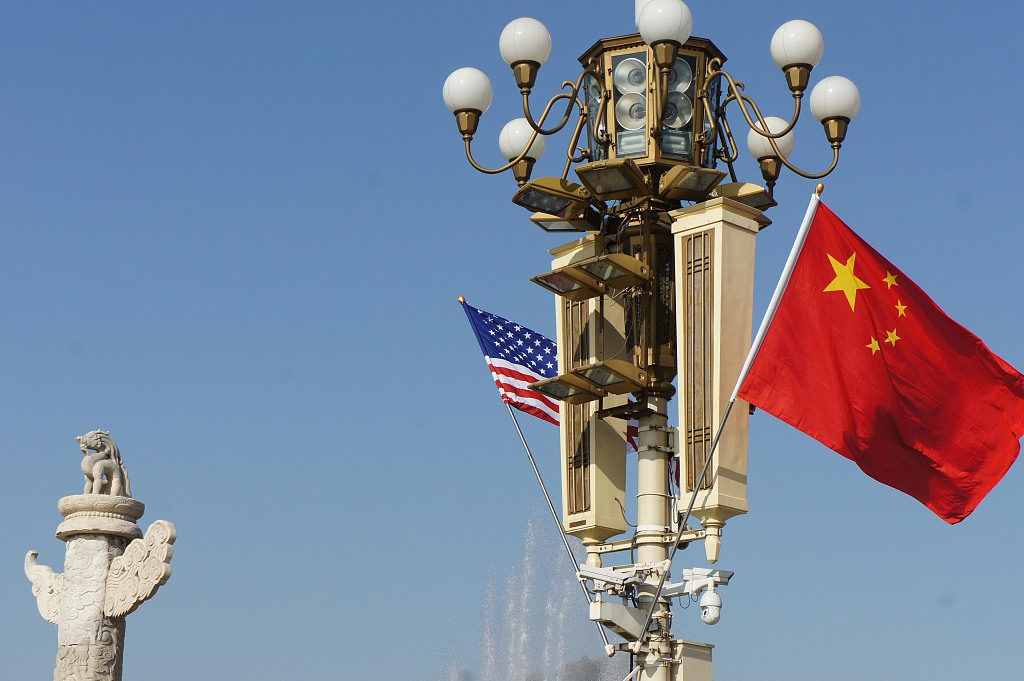 China, U.S. agree to jointly create favorable conditions for trade talks in October