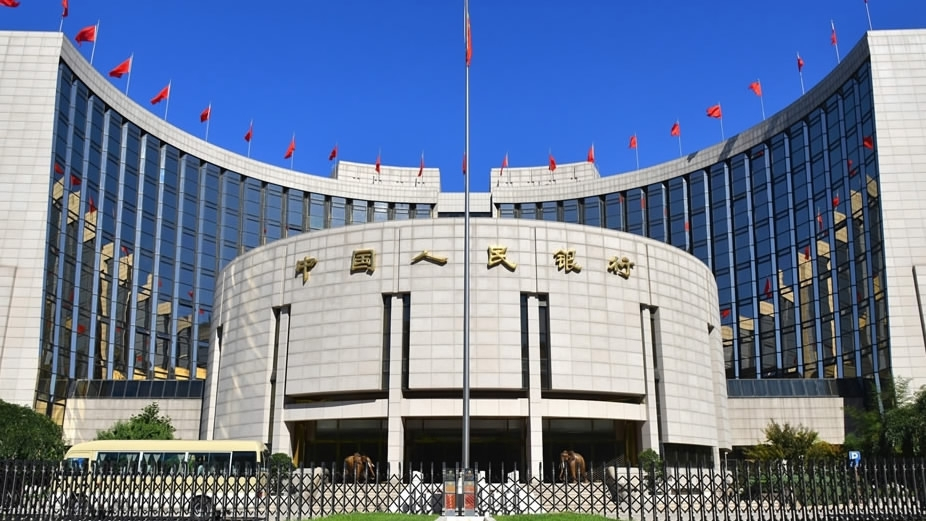 China cuts financial institutions' reserve ratios to boost lending