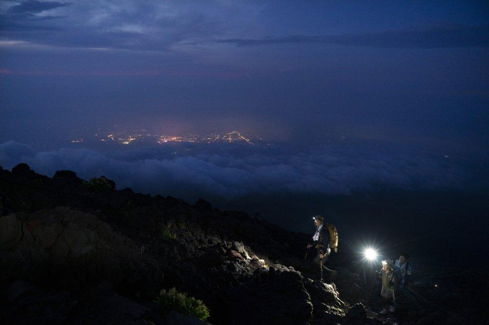 Making the climb to the summit of majestic Mt Fuji