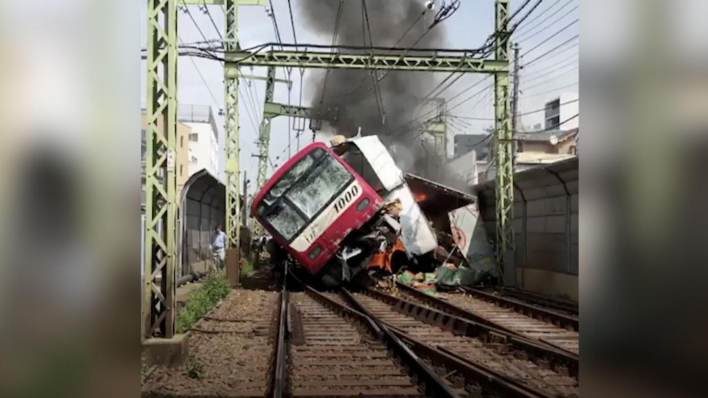 Truck collides with passenger train in Japan kills one, injures dozens