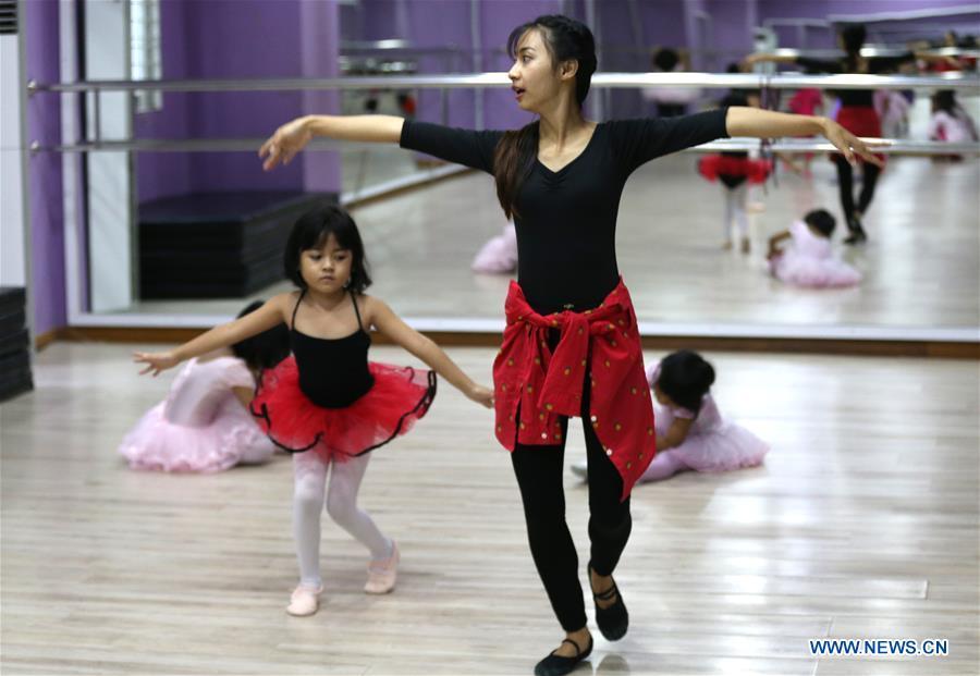Children practice ballet dance at Myanmar Ballet School in Yangon