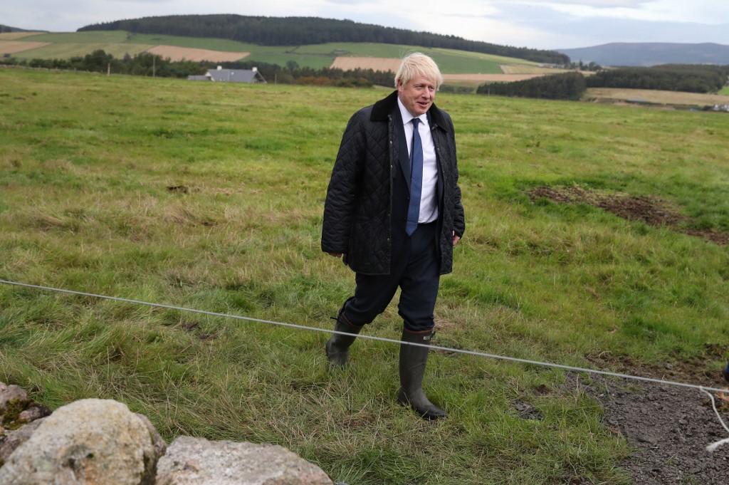 Britain's Johnson vows to fight on despite Brexit blows
