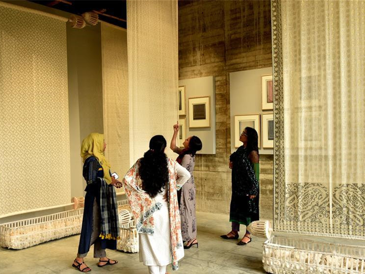 Visitors admire products of Jamdani during exhibition in Dhaka
