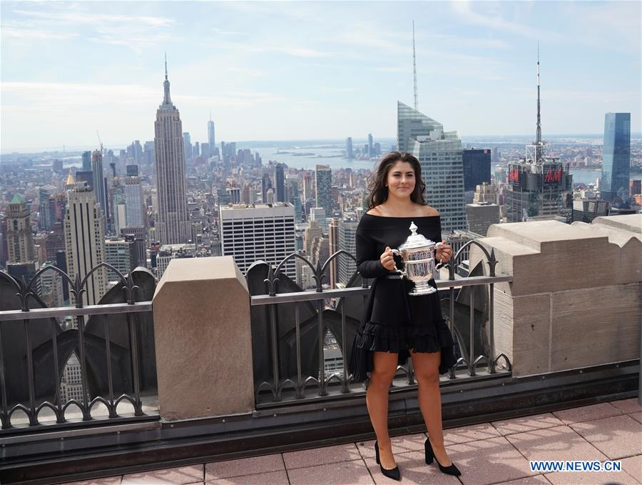 US Open winner Bianca Andreescu poses with her trophy in New York