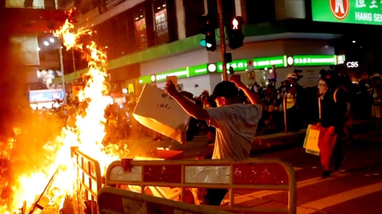 Protesters set fire outside police station, disrupt railway operation in HK
