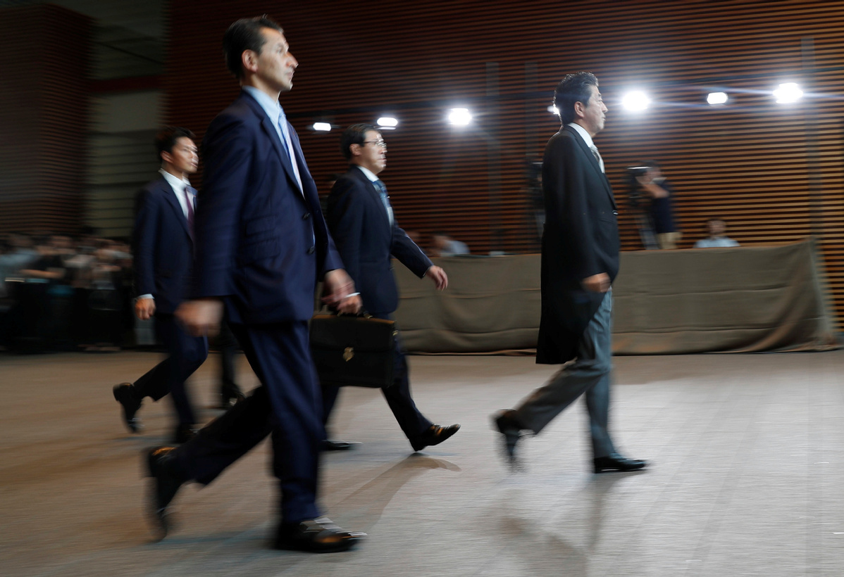 Japan's Abe reshuffles Cabinet in bid to boost public support, retains support of key allies