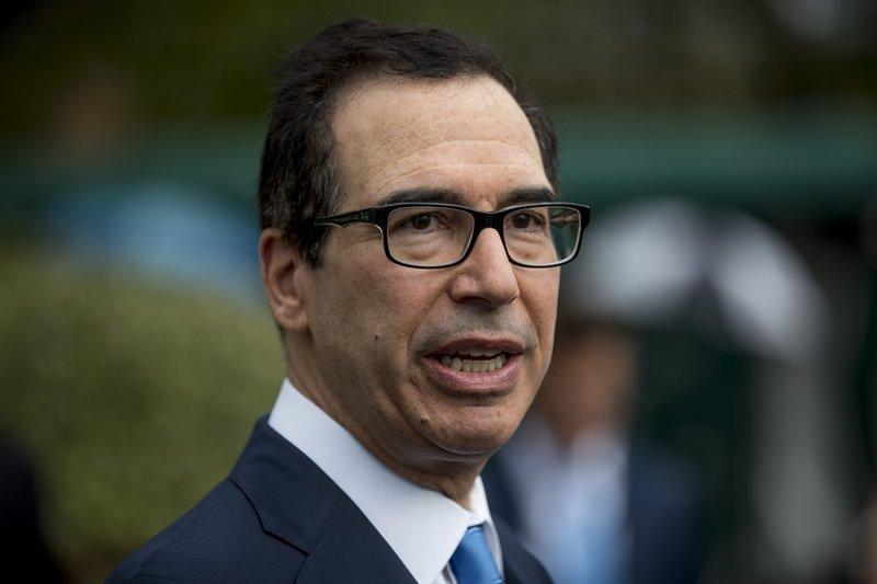 Officials spar with senators over plan for mortgage giants