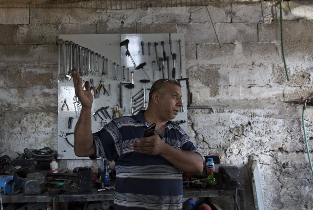 Unable to vote, Palestinians shrug off Israel's elections